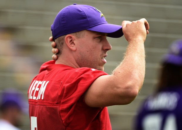 Minnesota Vikings quarterback Case Keenum pulls on his hat on the first morning of the team's football training camp at Minnesota State University in Mankato, Minn. on Monday, July 24, 2017. (Scott Takushi / Pioneer Press)