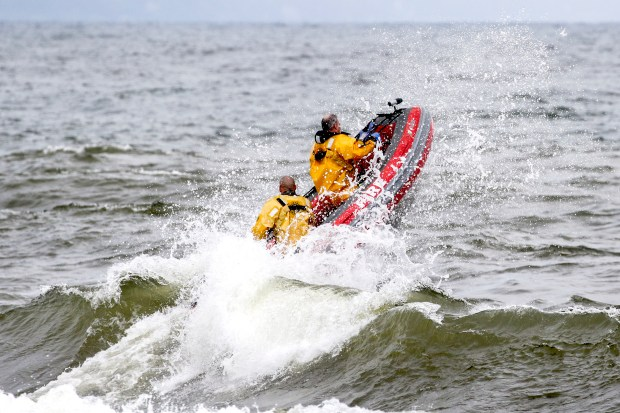 Personnel from the Duluth Fire Department battle large waves on Lake Superior on Thursday, Aug. 10, 2017, while searching for two missing swimmers near the Park Point Beach House in Duluth, Minn. After searching for more than an hour, a father and daughter, 10, from western Wisconsin were pulled from the lake and rushed to the hospital. Both died. (Clint Austin / Forum News Service)