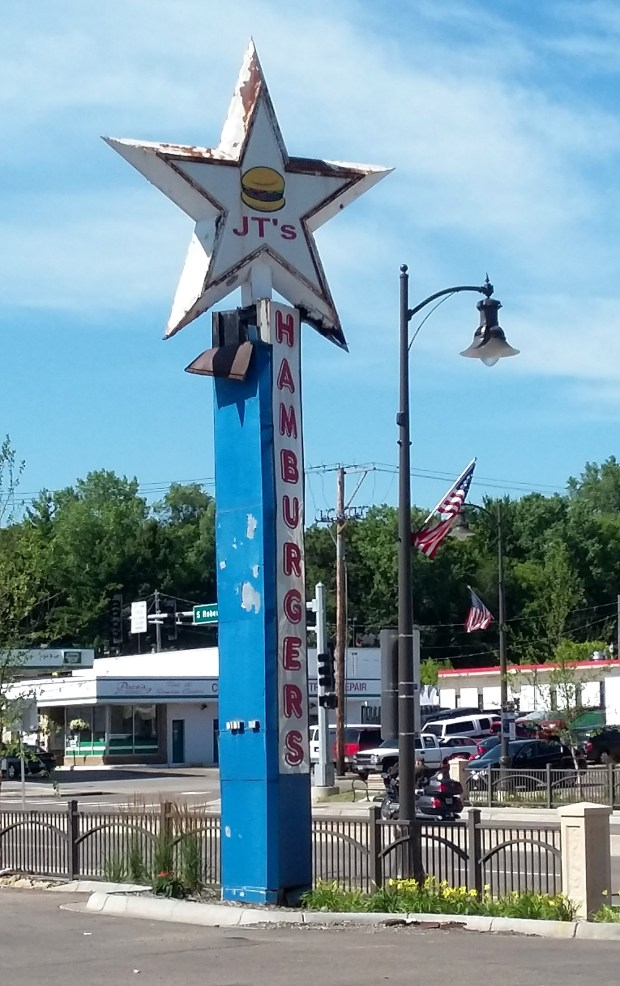 The iconic JT's Hamburgers pylon sign, which greeted visitors to the West St. Paul joint from the 1950s until the restaurant's recent closing, will live on at the Little Log House Pioneer Village in southern Dakota County. It will be moved in late August or early September 2017 to make room for a new Dunkin' Donuts-Baskin Robbins. (Courtesy of Elias Saman)