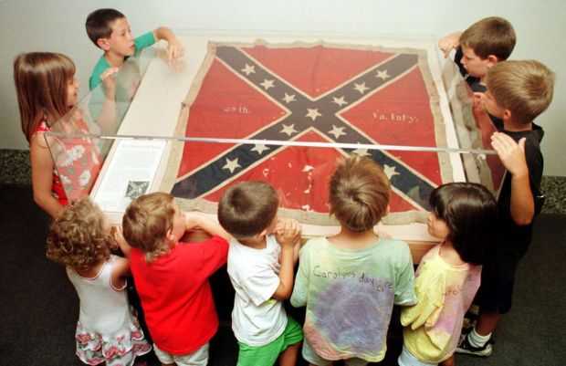 Students gaze at the Confederate battle flag at the Minnesota Historical Center in St. Paul in July 1998. It is no longer on public display. (Tom Olmscheid, via Associated Press)