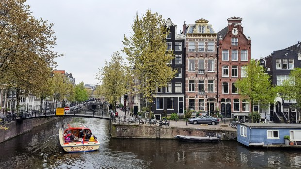 A boat motors through the canals of Amsterdam, May 3, 2017. (Andy Rathbun / Pioneer Press)