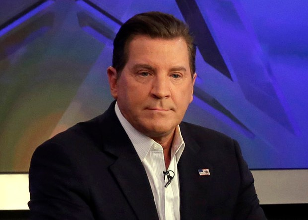 """In this July 22, 2015, photo, co-host Eric Bolling appears on """"The Five"""" television program, on the Fox News Channel, in New York. Bolling is suing the reporter who broke the story that he allegedly sent lewd text messages to colleagues. Bolling filed a $50 million defamation lawsuit Wednesday against Yashar Ali, a Huffington Post contributing writer. (AP Photo/Richard Drew)"""