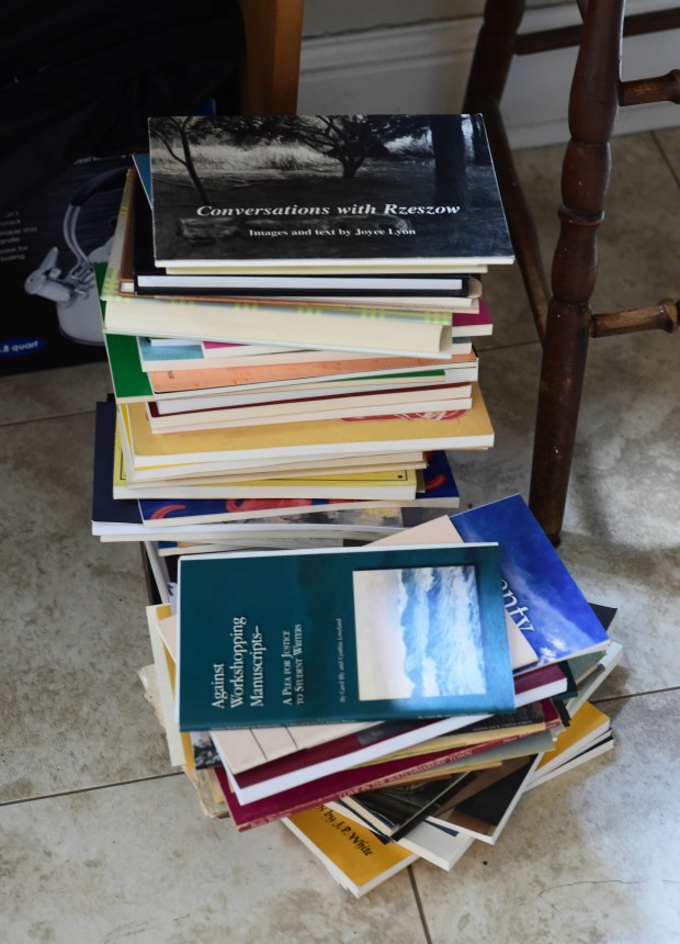 Poetry books are stacked up on Deborah Keenan's floor, as she teaches a poetry class in her St. Paul home, Monday, June 26, 2017. (Scott Takushi / Pioneer Press)
