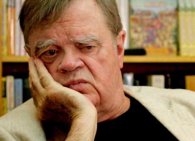 "In this July 26, 2017 photo, Garrison Keillor, creator and former host of, ""A Prairie Home Companion,"" appears at his St. Paul, Minn., office. Now that he has hung up his microphone as host of his popular public radio show, Keillor, who turns 75 this month, will embark on a 28-city ""Prairie Home Love & Comedy Tour 2017,"" which he vows will be his last. (AP Photo/Jeff Baenen)"