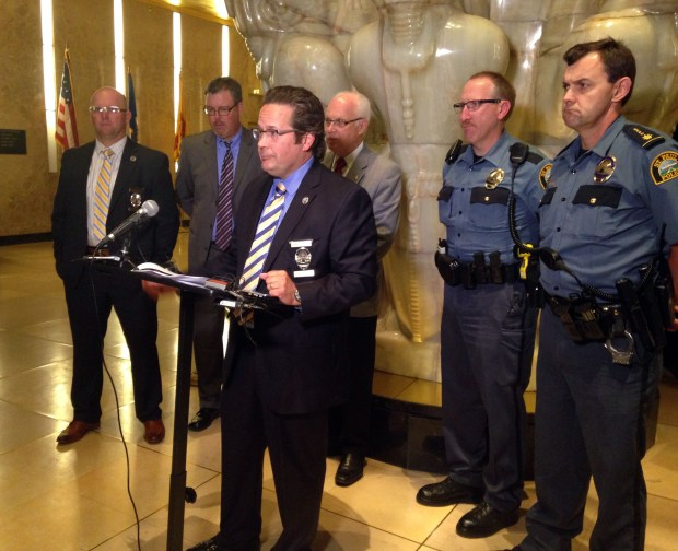 St. Paul Police Federation President Dave Titus speaks during a news conference about concerns over the re-constituted Police Civilian Internal Affairs Review Commission at St. Paul City Hall on Wednesday, Aug. 9, 2017. Behind Titus are, from left to right, Federation treasurer Mark Ross, Federation attorney Chris Wachtler, City Council Member Dan Bostrom, Federation Secretary Paul Kuntz and Federation Vice President Jim Falkowski. (Mara H. Gottfried / Pioneer Press)