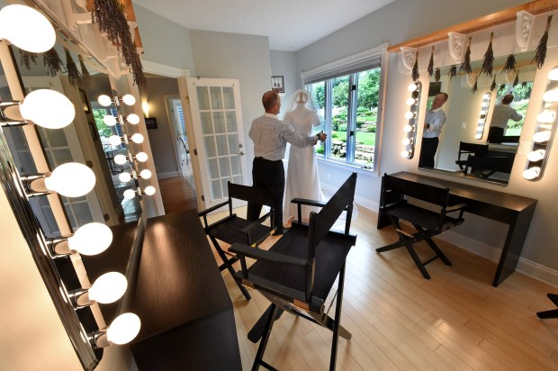 Matthew Stepaniak, property manager and descendant of Isaac Staples, shows his wife Tawnya's wedding gown (which is used as a display) in the professional makeup artists room for bridal parties and commercial shoots at 210 Laurel in Stillwater on Wednesday, July 16, 2017. The upscale mansion overlooking the St. Croix River is now available for short-term rentals. (Jean Pieri / Pioneer Press)