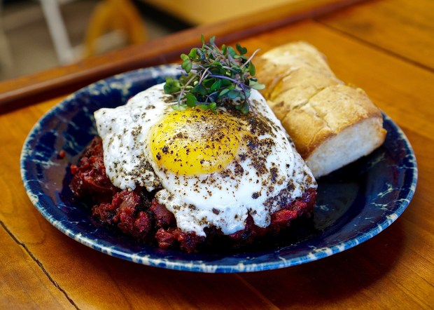At Love Handle in Indianapolis: Chicken gizzard beet hash with fried egg and Amelia's Pullman baguette. (Amber Gibson)