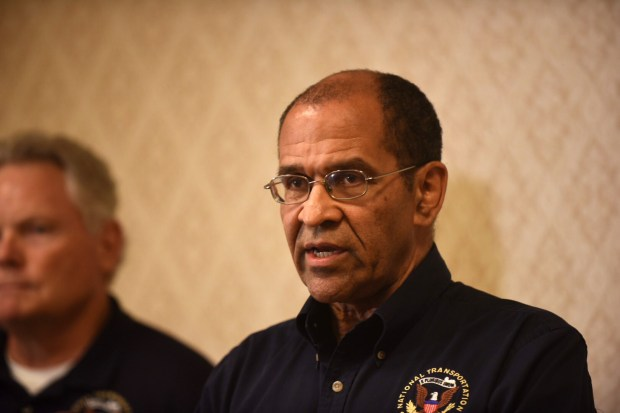 Christopher Hart, a member of the National Transportation Safety Board, speaks at a news conference at the Crowne Plaza hotel in Minneapolis as Roger Evans, left, a senior investigator with the NTSB, listens Thursday, Aug. 3, 2017. The federal agency is investigating Wednesday's natural gas explosion at Minnehaha Academy that leveled a building and killed two people. (Dave Orrick / Pioneer Press)