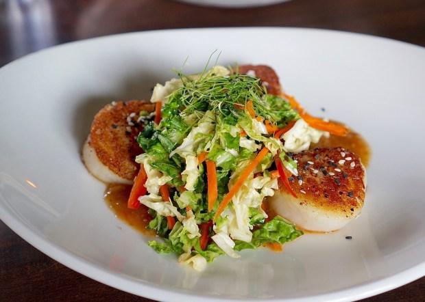 At Open Society in Indianapolis: Hokkaido scallops, Szechuan sauce, napa cabbage, carrots, sesame vinaigrette (Amber Gibson)