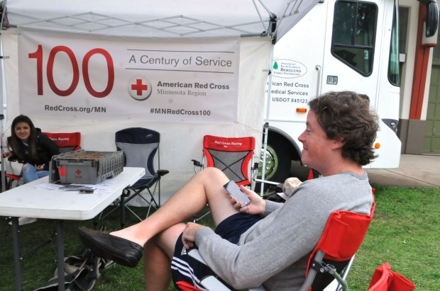 "Crop artist, Nick Rindo, of Minnetonka, relaxes in a chair right outside of the Ag-Hort Building at American Red Cross building at the Minnesota State Fair where people give blood. Rindo was waiting to give blood for the third time. ""It's a good way to get your blood sugar back up after all the fair food, so giving here makes a lot of sense,"" he said. The Amercian Red Cross urges eligible donors to end summer on a positive and potentially life saving note with a blood donation at the Great Minnesota Get-Together. Blood products are being distributed to hospitals almost as fast as donations are coming in. (Ginger Pinson / Pioneer Press)"