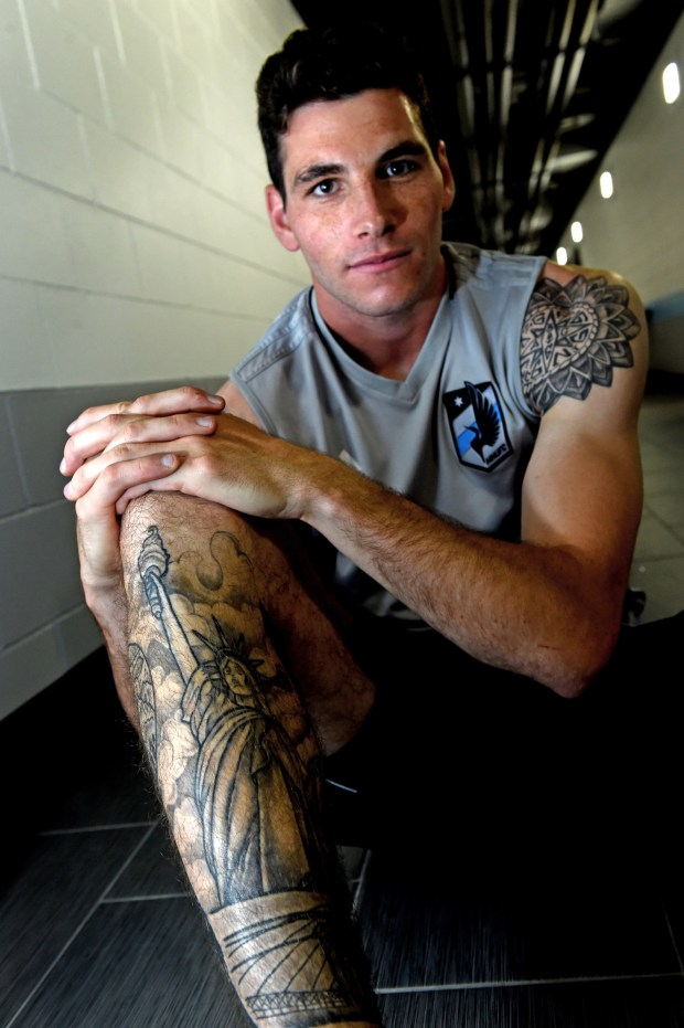 Minnesota United defender Joe Greenspan, a New Jersey native, has a lower right leg tattoo with depictions of the World Trade Center, Statue of Liberty and the Brooklyn Bridge. His left shoulder tattoo has the initials of all his family members and a small anchor to signify his service in the Navy. (Jean Pieri / Pioneer Press)