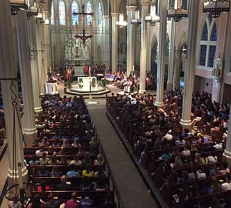 An estimated 800 people gathered at a Monday night vigil at Creighton University to remember Rosemount native Joan R. Ocampo-Yambing who was killed in a car crash. (Courtesy of Creighton University)