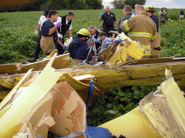 First responders work to save pilot Mark Kedrowski, who nearly died when his plane crashed just a few minutes after he took off from Lake Elmo Airport on Sept. 3, 2010. (Courtesy of the Washington County Sheriff's Office)