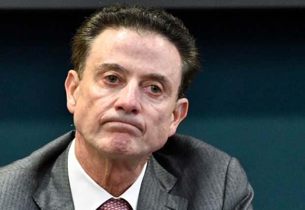 In this Oct. 20, 2016, photo, Louisville coach Rick Pitino reacts to a question during an NCAA college basketball press conference in Louisville, Ky. Louisville announced Wednesday, Sept. 27, 2017, that they have placed basketball coach Rick Pitino and athletic director Tom Jurich on administrative leave amid an FBI probe. (AP Photo/Timothy D. Easley)