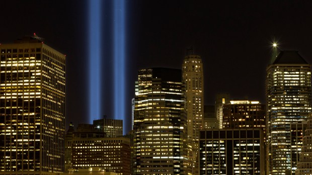 The Tribute in Light rises above the lower Manhattan skyline, Sunday, Sept. 10, 2017, in New York. The two blue pillars of light provide a visual reminder of how the Twin Towers, destroyed in the terrorist attacks of Sept. 11, 2001, once stood above the city skyline. (AP Photo/Mark Lennihan)