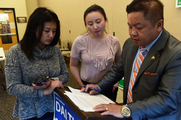 From left: Volunteers Julie Lo and Mai Chong Xiong work with Dai Thao, St. Paul mayoral candidate as he prepares to speak live on Facebook to his followers from the Rice Street Public Library in St. Paul, October 24, 2017. ( Scott Takushi: Pioneer Press)