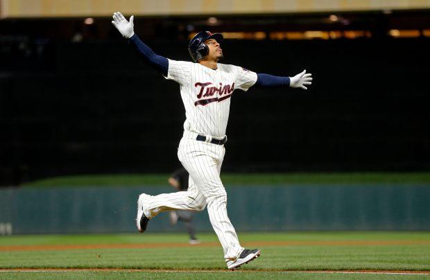 Minnesota Twins' Eduardo Escobar celebrates as he jogs home on a three-run home run off Kansas City Royals pitcher Trevor Cahill in the seventh inning of a baseball game Saturday, Sept, 2, 2017, in Minneapolis. (AP Photo/Jim Mone)