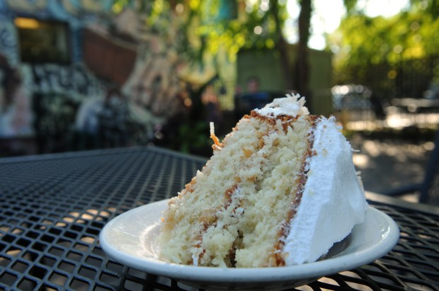 Coconut cake is served at Delicata, 1341 Pascal St. just off Como Avenue in St. Paul, on the patio on Wednesday, Sept. 20, 2017. (Ginger Pinson / Pioneer Press)