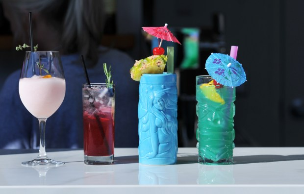 Drinks offered at the bar on the Lexington's new rooftop patio include, from left: A wine Frose, Blueberry Gin Shrub, Zombie (consisting of 3 rums and House Grenadine, and a Blue Scorpion. The rooftop patio will officially open on Tuesday, September 12, 2017. The media got a sneak preivew of the food, drinks and new spaces on Friday, September 8, 2017. (Ginger Pinson / Pioneer Press)