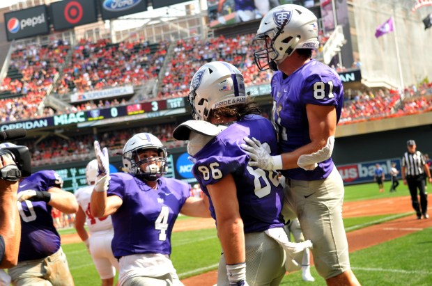 University of St. Thomas celebrate a 1st quarter TD against Saint John's in a NCAA Division III matchup. St. Thomas won 20-17. (Pioneer Press / Ginger Pinson)