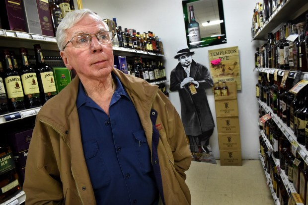 """""""I think he (gangster Al Capone, seen in an advertising cutout in the background) would be content with the old bridge; more cop cars could chase him on the new bridge,"""" said Al Severson, 74, owner at B & L Liquor in Houlton, Wis. on Wednesday, Sept. 6, 2017. The Stillwater Lift Bridge that led drivers to the Wisconsin town of Houlton has been closed and traffic rerouted to the new St. Croix River bridge, turning his once-busy highway into a dead-end street. Severson, who has owned the liquor store since 1989, said his business has dropped way down with the opening of the St. Croix River Bridge and since Sunday liquor sales are now allowed in Minnesota. He said Capone used to come across the Stillwater Lift Bridge on his way to and from Chicago. (Jean Pieri / Pioneer Press)"""