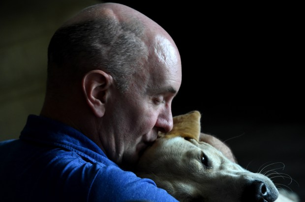 Mark Kedrowski nuzzles up with his therapy dog, Enzo. (Jean Pieri / Pioneer Press)