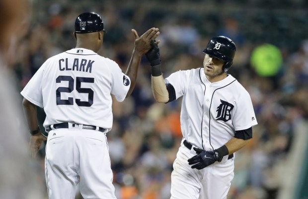 Detroit Tigers' Ian Kinsler is greeted by third base coach Dave Clark (25) after hitting a solo home run during the sixth inning of a baseball game against the Minnesota Twins, Friday, Sept. 22, 2017, in Detroit. (AP Photo/Carlos Osorio)