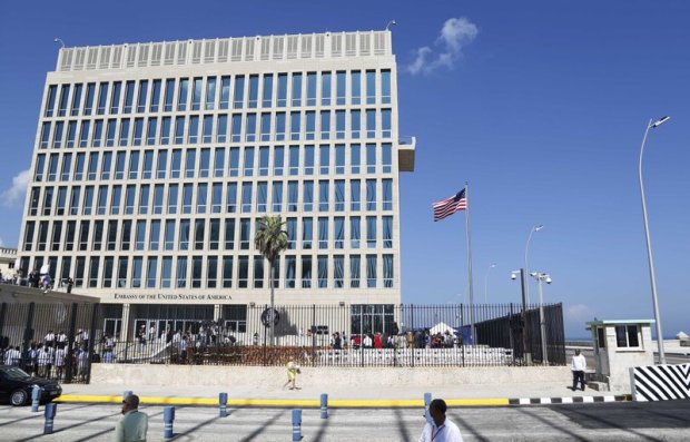 In this Aug. 14, 2015, file photo, a U.S. flag flies at the U.S. embassy in Havana, Cuba. The Associated Press has obtained a recording of what some U.S. Embassy workers heard in Havana, part of the series of unnerving incidents later deemed to be deliberate attacks. (AP Photo/Desmond Boylan, File)
