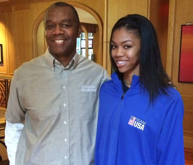 Longtime NFL quarterback Randall Cunningham poses with his daughter Vashti, one of the world's top high jumpers, in Portland, Ore., Friday, March 18, 2016. Vashti Cunningham, 18, is competing in the high jump at the U.S. indoor track and field championships this week in Portland. (AP Photo/Pat Graham)