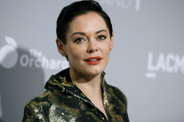 "In this April 15, 2015 photo, Rose McGowan arrives at the LA Premiere Of ""DIOR & I"" held at the Leo S. Bing Theatre on Wednesday, April 15, 2015, in Los Angeles.  McGowan's Twitter account has been suspended, temporarily muting a central figure in the allegations against Harvey Weinstein. McGowan said late Wednesday, Oct. 11, 2017,  that Twitter had suspended her from tweeting after the social media company said she broke its rules. (Photo by Richard Shotwell/Invision/AP)"