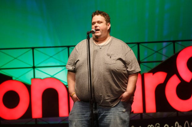 In this photo from June 13, 2015, Ralphie May performs at the 2015 Bonnaroo Music and Arts Festival in Manchester, Tenn. A spokeswoman for Ralphie May says the comedian has died at age 45. In a statement Friday, Oct. 6, 2017, publicist Stacey Pokluda said May died of cardiac arrest. She said he had been fighting pneumonia, which caused him to cancel a few appearances in the past month. (Photo by John Davisson/Invision/AP, File)
