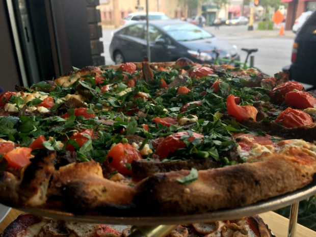 Persian beef, tomato, feta and harissa pizza at Black Sheep Coal Fired Pizza, photographed Aug. 31, 2017. (Nancy Ngo / Pioneer Press)