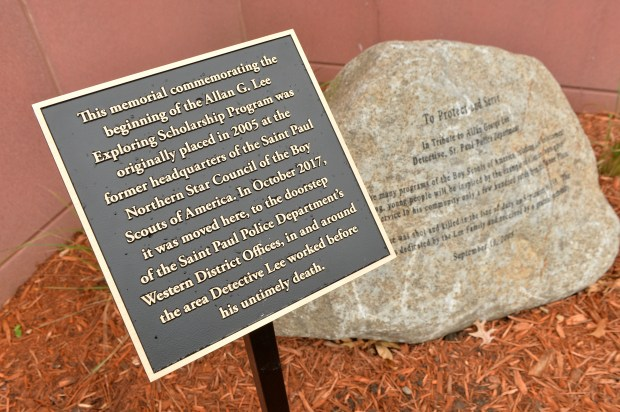 The Allan G. Lee memorial stone, previously located on Marshall Avenue, was moved to a spot and dedicated in front of the Western District Police Headquarters in St. Paul on Hamline Avenue, Oct. 30, 2017. St. Paul Police Detective Allan G. Lee was shot and killed by a robbery suspect in 1949. (Scott Takushi / Pioneer Press)