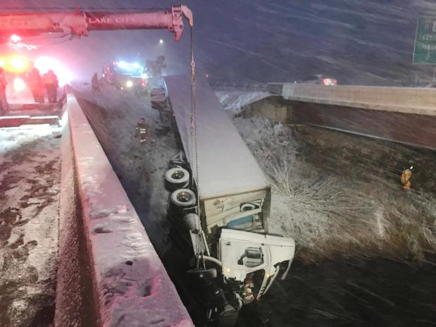 A semitrailer slid off Interstate 35 and into the St. Louis River in Northeast Minnesota amid snowy conditions early Friday, killing the driver. (Cloquet Area Fire District photo)
