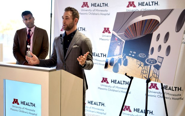 Minnesota Wild's Jason Zucker, right, announces a donation of $160,000 for the building of the Zucker Family Suite and Broadcast Studio at the University of Minnesota Masonic Children's Hospital in Minneapolis on Monday, Oct. 16. 2017. (Courtesy of Jim Bovin Photography)