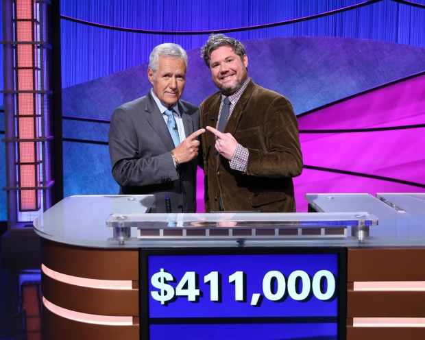 """Jeopardy!"" host Alex Trebek with Austin Rogers, a graduate of Macalester College in St. Paul, whose winning streak ended Thursday, Oct. 12, 2017. (Courtesy of ""Jeopardy!"")"