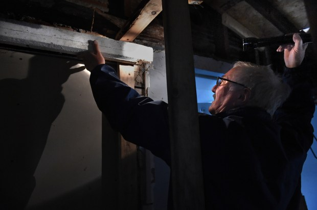 John Yust shows the head casing from the original doorway, built in 1856, at 412 Goodrich Avenue in St. Paul Thursday, Oct. 26, 2017. (Jean Pieri / Pioneer Press)