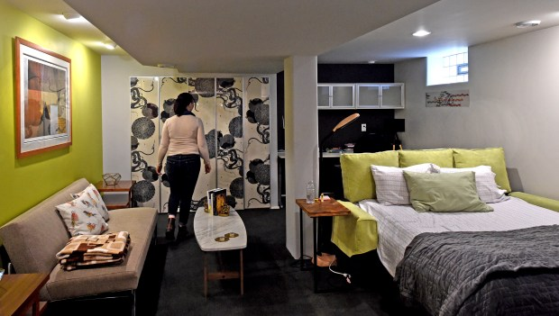 Estelle Smith shows the downstairs living space she rents out in her Minneapolis home on Friday, Oct. 20, 2017. Smith, a University of Minnesota Ph.D. computer science student, is a local Airbnb host who leases her full basement -- including living space, bedroom and huge new shower -- to a student. (Jean Pieri / Pioneer Press)