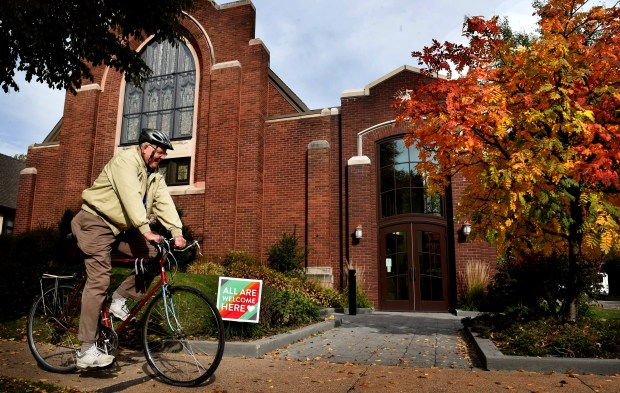 """Mark Seeley bikes home from Fairmount Avenue United Methodist Church in St. Paul Wednesday, Oct. 18, 2017. """"I'm a lifelong bicyclist. It keeps me from weighing 350 pounds,"""" he said. The church will mark its 100th year at its present location near Macalester College with a series of anniversary celebrations. Seeley, the church historian, is a climatologist at the University of Minnesota and a climate commentator on MPR Morning Edition and TPT's Almanac. (Jean Pieri / Pioneer Press)"""