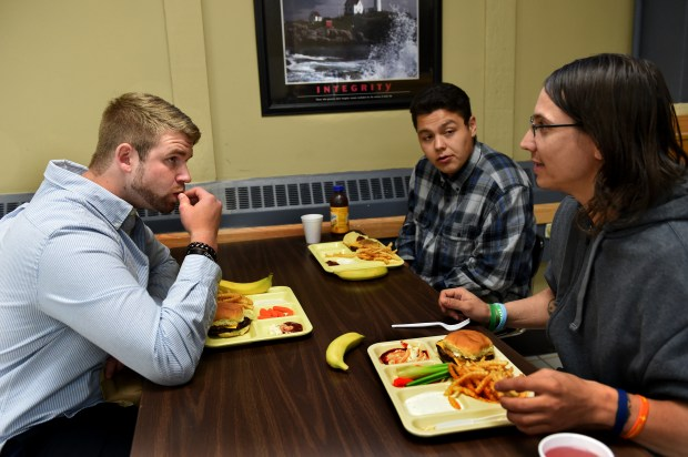 From left, Joe Nickelson, Gordon Basswood and Tom Johnson eat lunch at Minnesota Adult Teen Challenge in Minneapolis on Thursday, Sept. 28, 2017. They are all recovering from opioid addiction. (Jean Pieri / Pioneer Press)