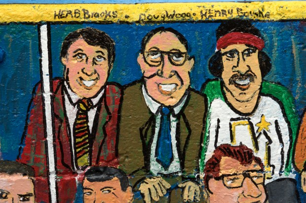 "Minnesota hockey legends, from left, Herb Brooks, Doug Woog, and Henry Boucha are included in Richard Hubal's mural ""Hockey Town U.S.A."" (Matthew Weber / Pioneer Press)"