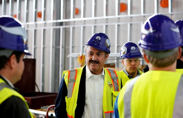 Team owner Zygi Wilf during a tour of the Minnesota Vikings headquarters in Eagan Monday, Oct. 23, 2027. The Twin Cities Orthopedics Performance Center is 70 percent completed. The Vikings are scheduled to move there in less than six months. The Minnesota Vikings and partners provide the first media tour of the Twin Cities Orthopedics Performance Center and surrounding development in Eagan on Monday, Oct. 23, 2017. Representatives from the Vikings, Kraus Anderson and Twin Cities Orthopedics led a guided walking tour of the Vikings 40-acre future headquarters and training facility with stops in the locker room, weight room, cafeteria, auditorium, media center and the indoor practice facility. A brief bus tour also provided a look at surrounding development, including TCO's medical office building and sports medicine center adjacent to the TCO Performance Center. (Courtesy of the Minnesota Vikings)