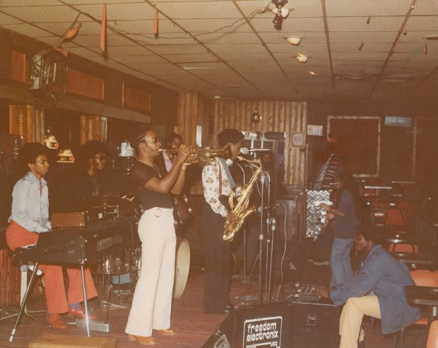 The Family -- featuring Pierre Lewis on keyboards, Joe Lewis on drums, Jeff Tresvant on trumpet, Bill Perry on saxophone, Sonny Thompson on bass, and Randy Barber on guitar (pictured mixing on sound board) -- perform a sound check at the Metro Lounge in St. Paul in 1977. (Courtesy of Charles Chamblis/Minnesota Historical Society)
