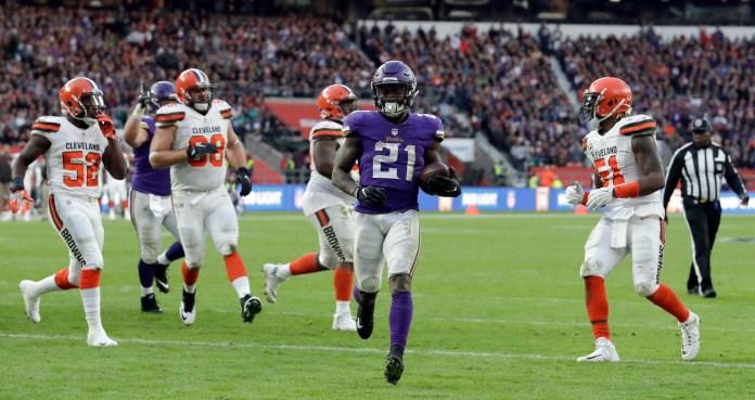 Minnesota Vikings running back Jerick McKinnon (21) scores on a 1-yard touchdown run during the second half of an NFL football game against Cleveland Browns at Twickenham Stadium in London, Sunday Oct. 29, 2017. (AP Photo/Matt Dunham)