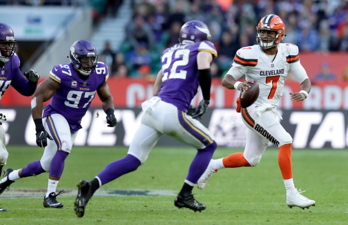 Cleveland Browns quarterback DeShone Kizer (7) scrambles away from Minnesota Vikings safety Harrison Smith (22) and defensive end Everson Griffen (97) during the second half of an NFL football game at Twickenham Stadium in London, Sunday Oct. 29, 2017. (AP Photo/Tim Ireland)
