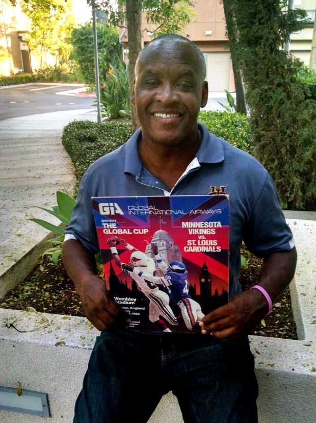 Former Minnesota Vikings running back Darrin Nelson, shown at his home in Irvine, Calif., holds a poster from the 1983 Vikings-St. Louis Cardinals preseason game, the first-ever NFL game played in London. (Courtesy of Darrin Nelson)