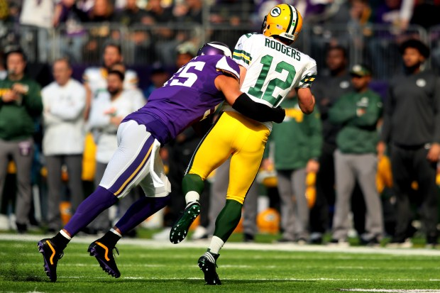 Anthony Barr (55) of the Minnesota Vikings hits quarterback Aaron Rodgers (12) of the Green Bay Packers during the first quarter of the game on Oct. 15, 2017, at US Bank Stadium in Minneapolis. The hit resulted in a broken collar bone for Rodgers. (Photo by Adam Bettcher/Getty Images)