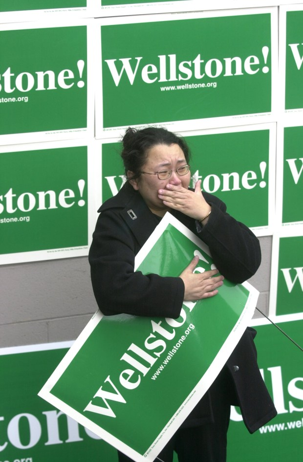 Hmong outreach coordinator for the Paul Wellstone campaign, Pakou Hang, St. Paul, Mn., weeps as she listens to speakers eulogize Senator Paul Wellstone and his family who died in a plane crash in Eveleth, Mn., Friday morning.