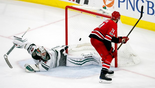 Carolina Hurricanes' Jaccob Slavin (74) shoots the puck past Minnesota Wild goalie Alex Stalock (32) to win the shootout during an NHL hockey game, Saturday, Oct. 7, 2017, in Raleigh, N.C. (AP Photo/Karl B DeBlaker)