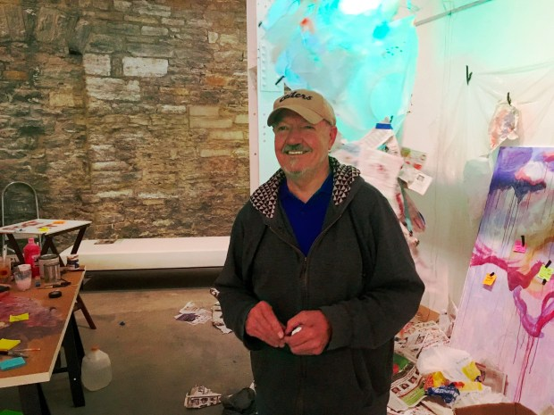 Keith Pederson stands in front of one of the elements in his installation. (Lauren Otto / Pioneer Press)